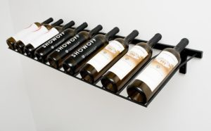 9 bottle long display rack. Set at a 15 degree angle, this is a wall mounted presentation display rack that comes in Satin Black, Platinum Series Nickel Finish, Black Chrome, or Chrome colours.