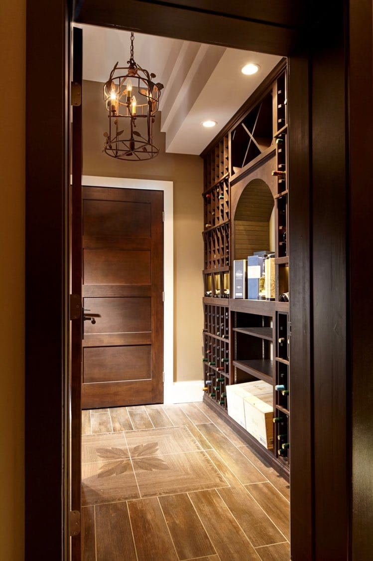 See interior designer 39 s traditional wood wine racks for Wine cellar layout