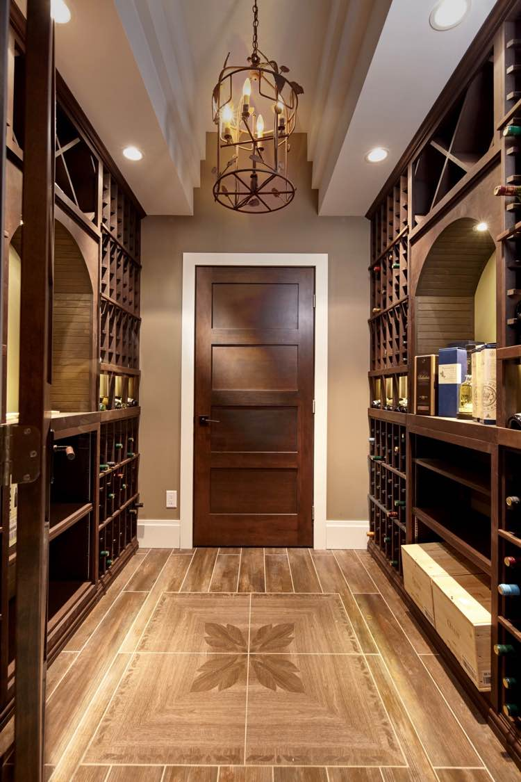 See interior designers traditional wood wine racks in interior designers west vancouver home wine cellar dances with style with traditional knotty alder wood wine racks mozeypictures Images
