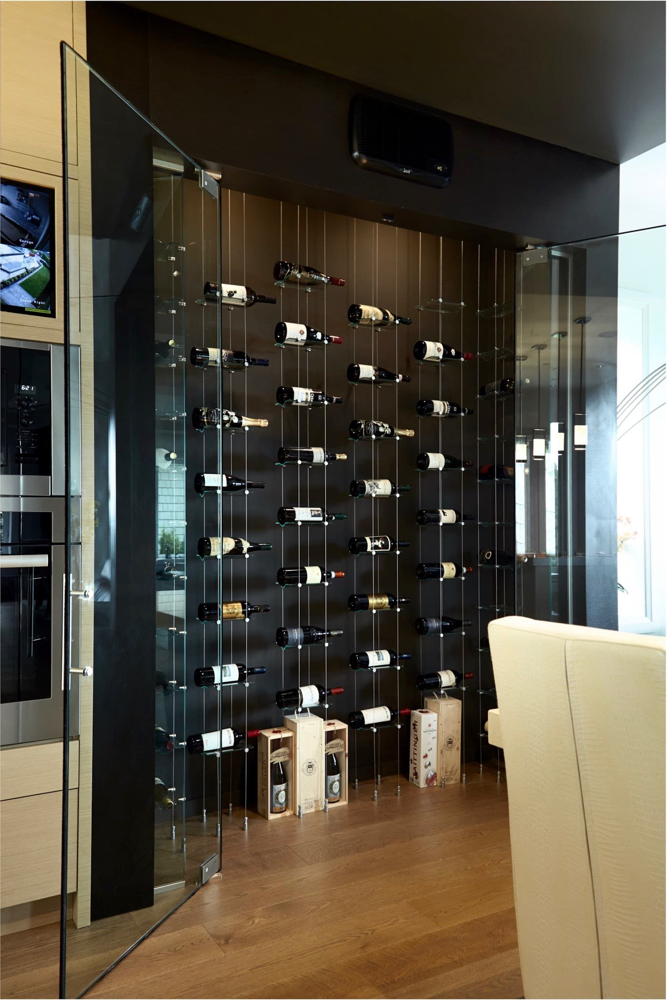 modern cable floating wine racks wow guests in vancouver home - a closer look of the interior of the vancouver wine cellar with floating wineracks and
