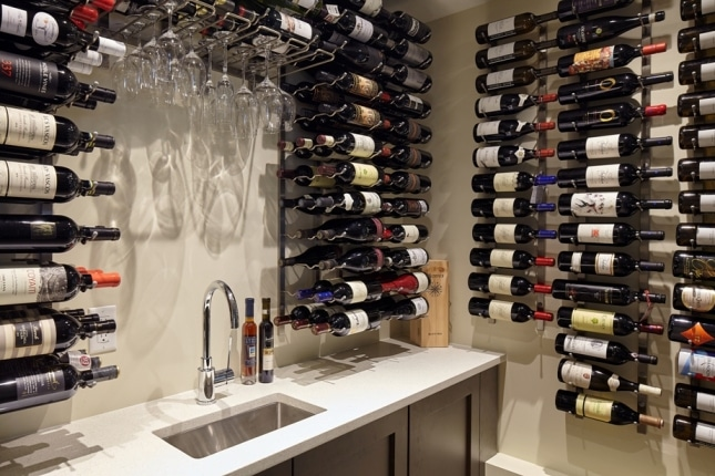 Bar Sink And Faucet Installed To Stone Countertop North S Modern Wine Cellar Project